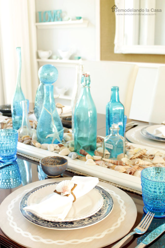 blue bottles, wooden placemats, blue cups - tablescape