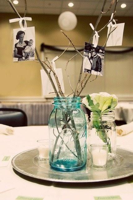 centros de mesa para bodas con fotos de los novios