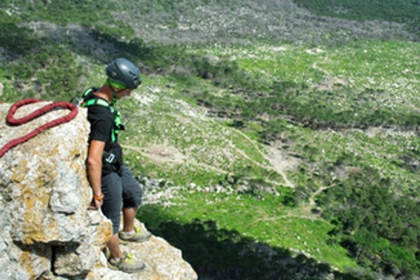 Stag on cliff edge ready to abseil for charity