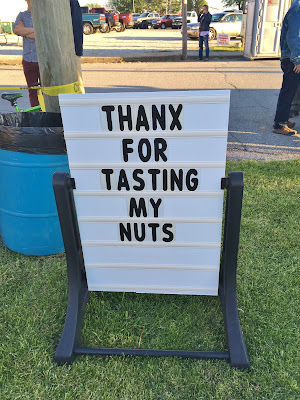 """Sign says, """"Thankx for tasting my nuts"""" at the Testicle Festival"""
