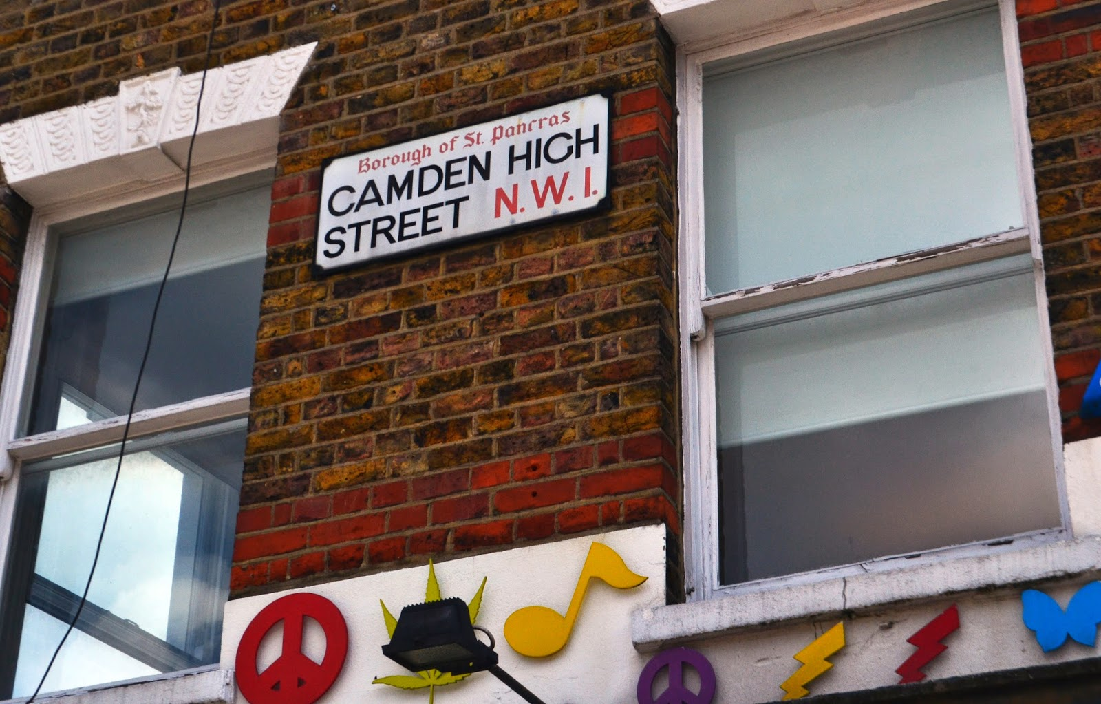 Camden high street sign on the wall of a house