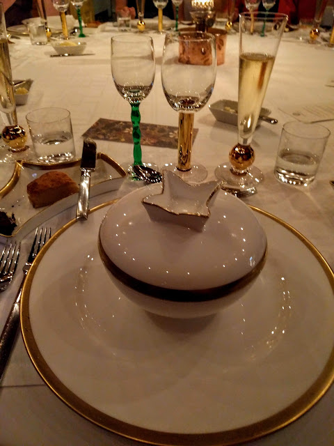Covered dish containing the first course of our Nobel Prize dinner at Stadshuskällaren Restaurang at the Stockholm City Hall