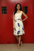 Actress Ritu Varma Stills in White Floral Short Dress at Kesava Movie Success Meet .COM 0165.JPG