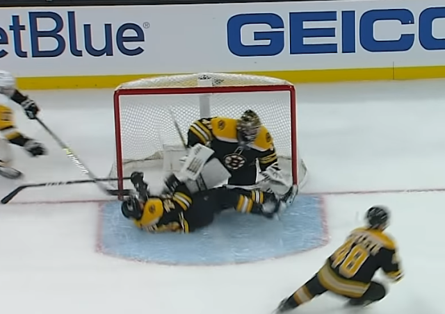 Boston Bruins defenseman Charlie McAvoy slams into goalpost head-first 11/4/2019