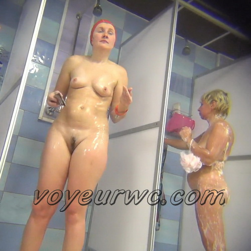 A hidden camera in a public shower films gorgeous women while they soap up their bodies (Hidden Camera Public Shower 91-103)
