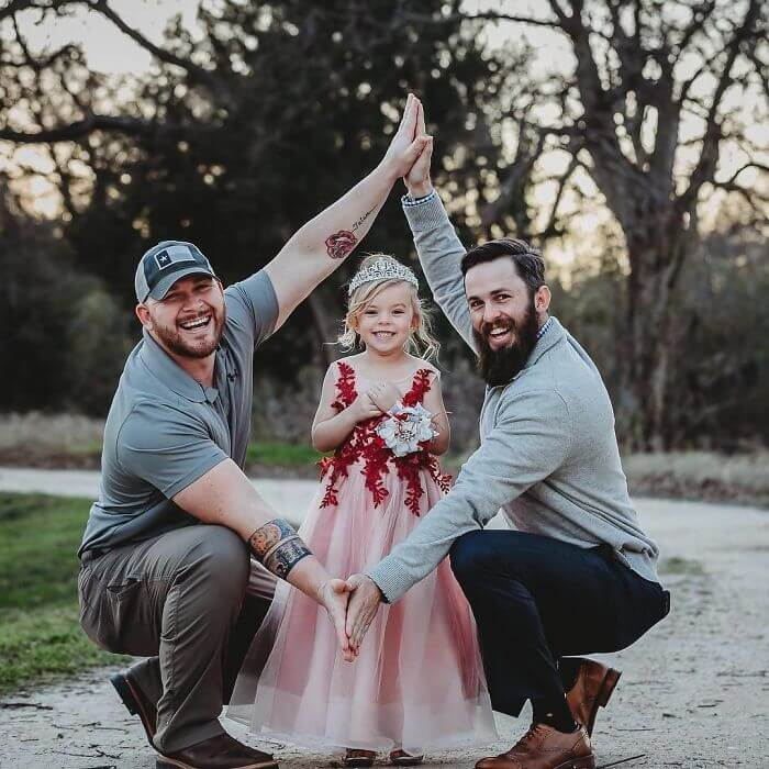 Cute Photoshoot Of A Girl With Her Two Dads