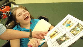 Savannah Borden laughing at pictures of herself at school