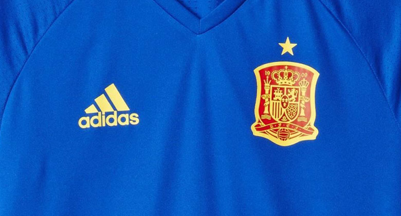 A bold red is combined with striking blue and yellow accents for the Spain  Euro 2016 Training Jersey. b778b42c1