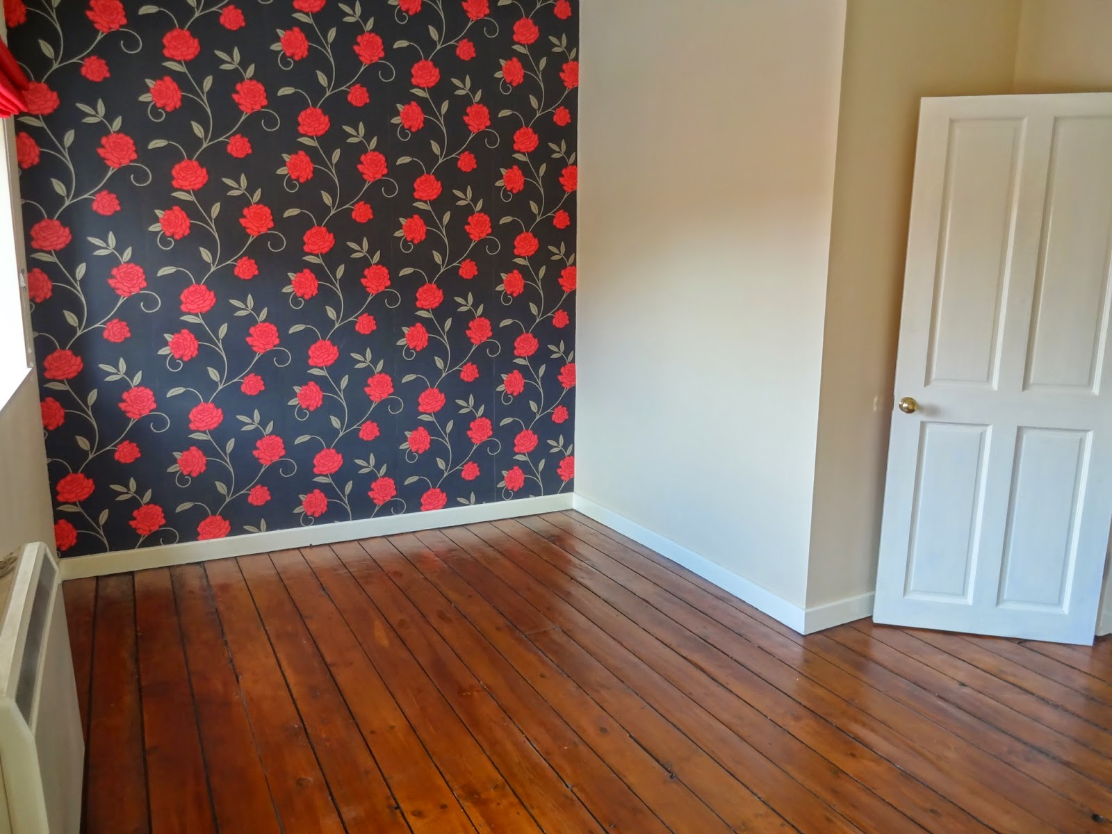 black and red floral wallpaper in bedroom