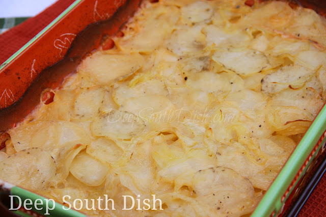 Thin slices of seasoned potatoes, layered with onion and baked in a buttery milk sauce.