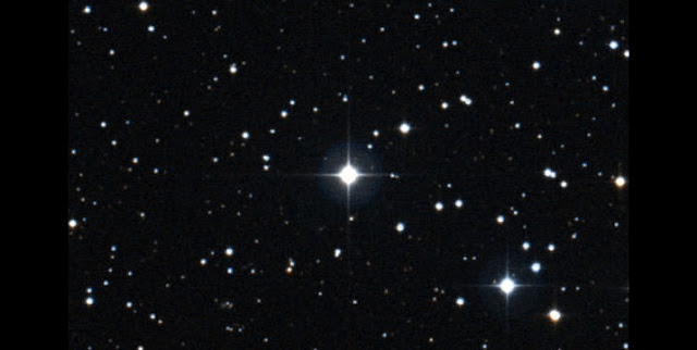 The ninth-magnitude star BD+44 493 (center) is by far brightest among the stars in this area. (DSS images from STScI and AAO/ROE)