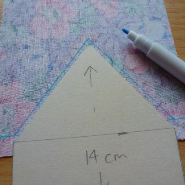 Drawing around roof shape onto fabric with a water erasable pen