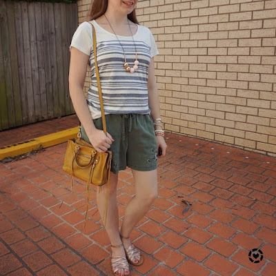 awayfromtheblue Instagram | striped tee olive shorts mustard yellow micro regan bag park playdate summer outfit