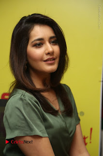 Actress Raashi Khanna Stills in Green Short Dress at Mirchi 95 Suno Aur Mercedes Jeeto Contest  0116.JPG