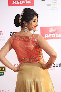Harshika Ponnacha in orange blouuse brown skirt at Mirchi Music Awards South 2017 ~  Exclusive Celebrities Galleries 007.JPG