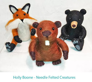small needle felted fox, beaver and bear in a seated position