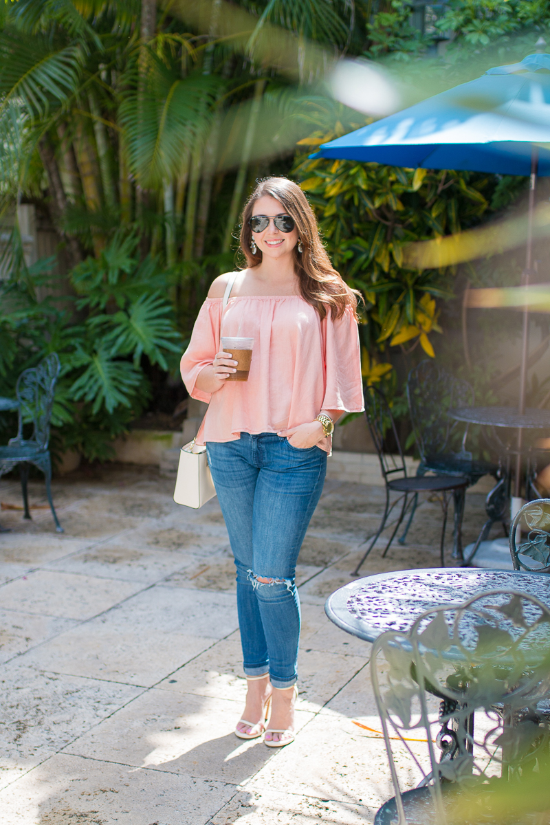 Blush off the shoulder top from Glam and distressed DL1961 jeans.