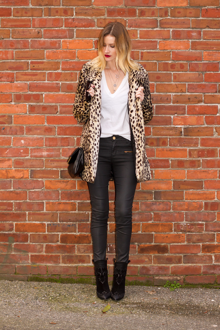 Vancouver Fashion Blogger, Alison Hutchinson, wearing Urban Outfitters leopard print coat, American Apparel Tee Shirt, Zara coated black skinny jeans, Zara high heel western boots, Tiffany heart necklace, Pyrrha shamrock necklace, and La Dama Necklace