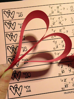 Miss Math Dork Valentine's Day math adding and subtracting fractions activity chain of hearts