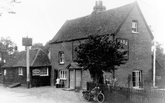 Photograph of  The Old Maypole, Water End, 1920. It claims to date from 1520; the building appears to be 16 or 17th century. In 1871 the licensee was Mary Ann Massey, whose brother Walter ran the blacksmith shop adjoining the pub