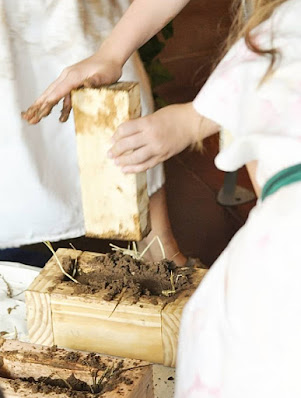 (From a blog post on how to make mud bricks like the ancient Egyptians) Picture showing how to pack down the bruck using a short 2x4 piece.