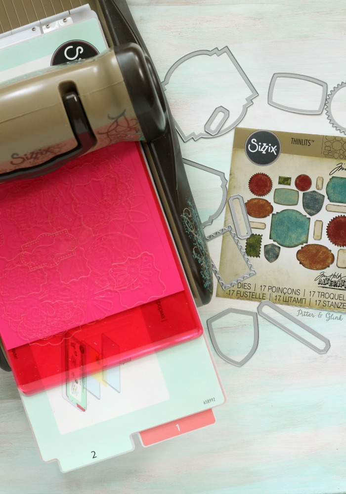 Cutting paper with the Sizzix BIGkick and Tim Holtz's Label Thinlits |pitterandglink.com