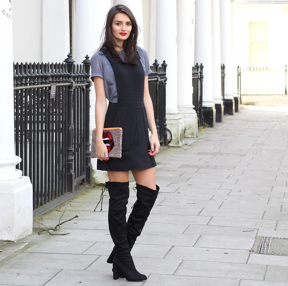 peexo fashion blogger wearing black pinfore and knee high boots
