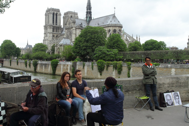 Street artists weave their magic in front of Notre Dame Cathedral, Paris