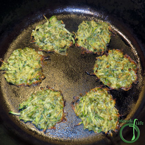 Morsels of Life - Zucchini Fritters Step 3 - Heat oil in a pan and spoon some zucchini mixture into the pan. Cook until crispy on both sides.