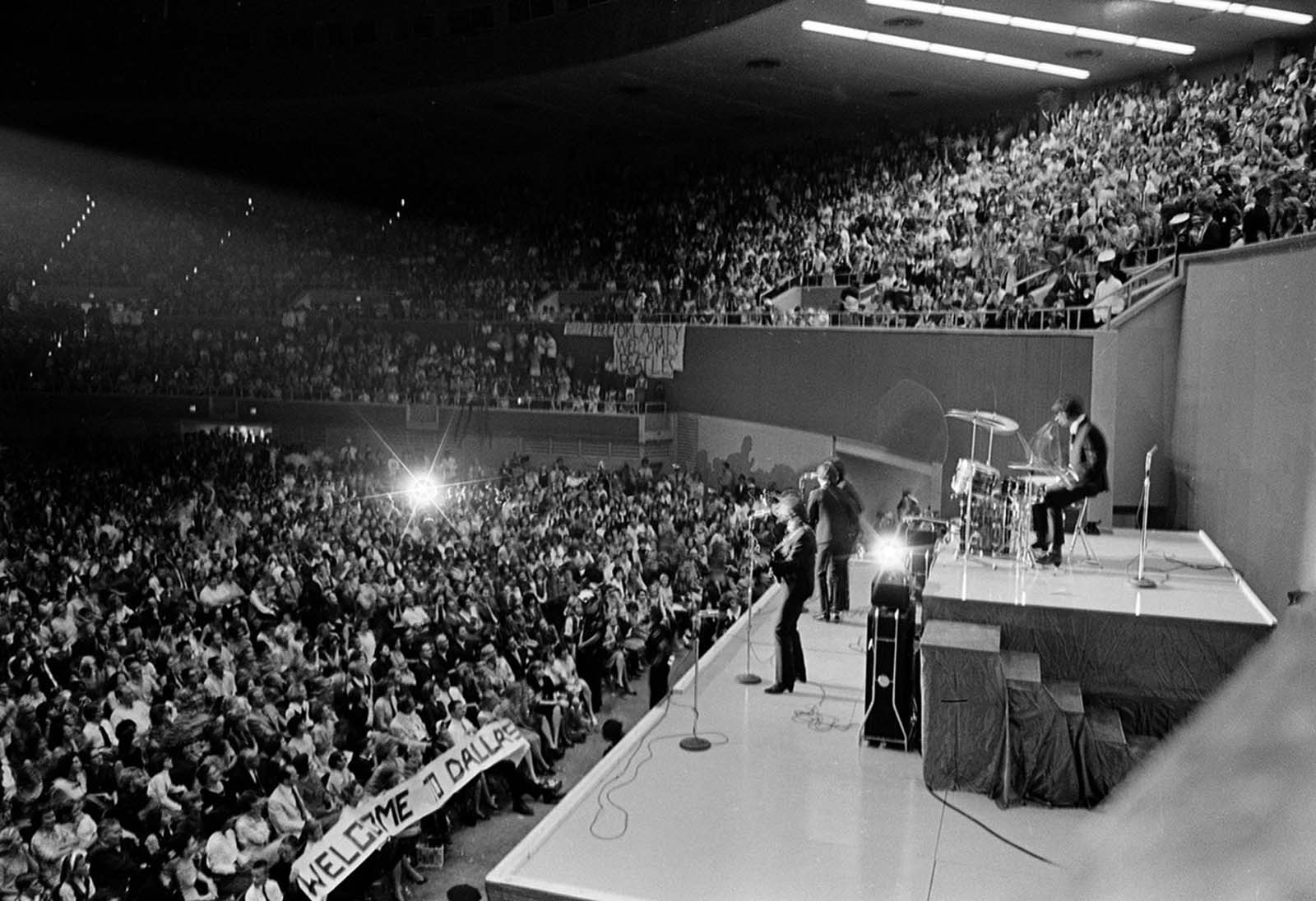 The British rock and roll band the Beatles perform at the Memorial Coliseum in Dallas, Texas, on September 18, 1964 on their second U.S. tour.