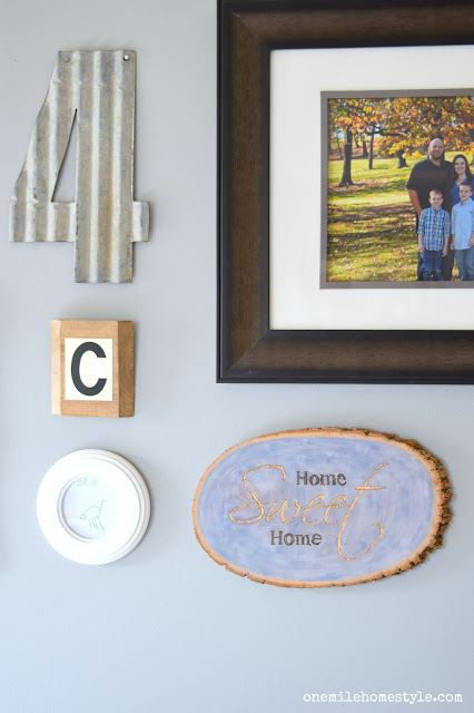 Family Room Gallery Wall with Blue and Gold Home Sweet Home Art - One Mile Home Style