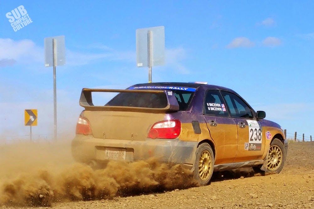 Subaru kicking up dirt at rally