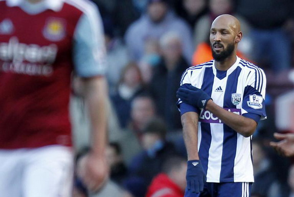 Nicolas Anelka touches his sleeve as he celebrates scoring West Brom's first goal against West Ham