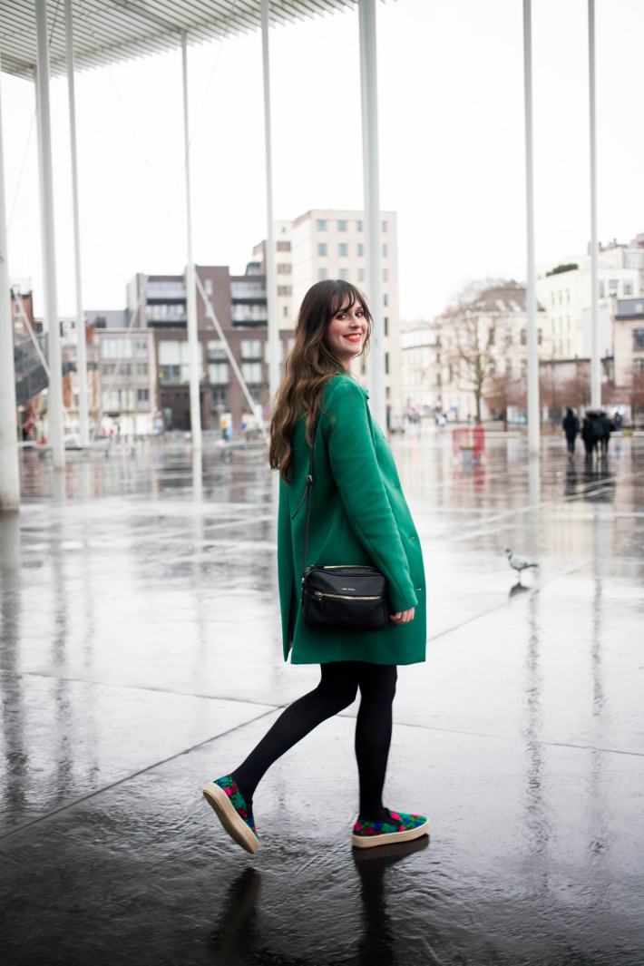 green coat, pleather skirt and embroidered espadrilles