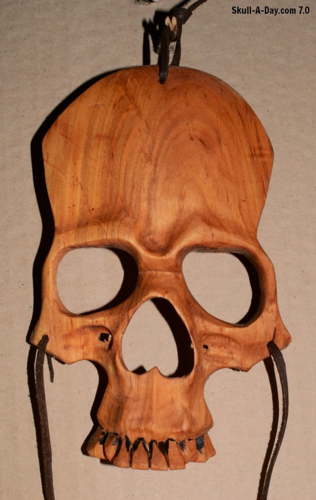Robertas Wooden Skull Mask on the giving tree
