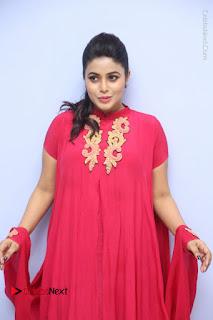 Actress Poorna Latest Stills in Red Dress at Rakshasi First Look Launch  0111.JPG