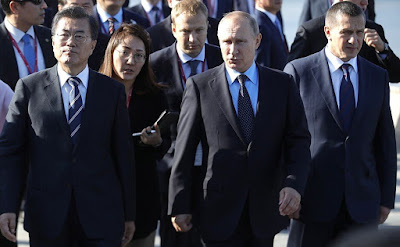 Vladimir Putin and President of South Korea Moon Jae-in.