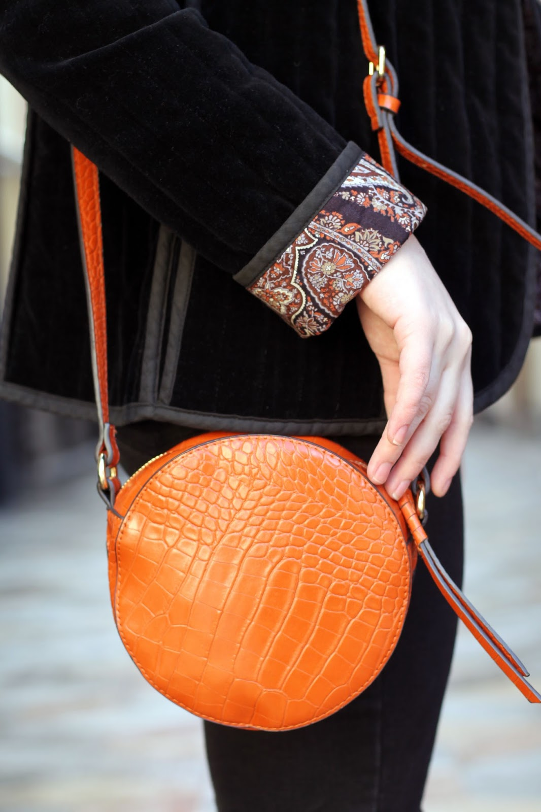 burned orange round circle cross body bag in mock croc