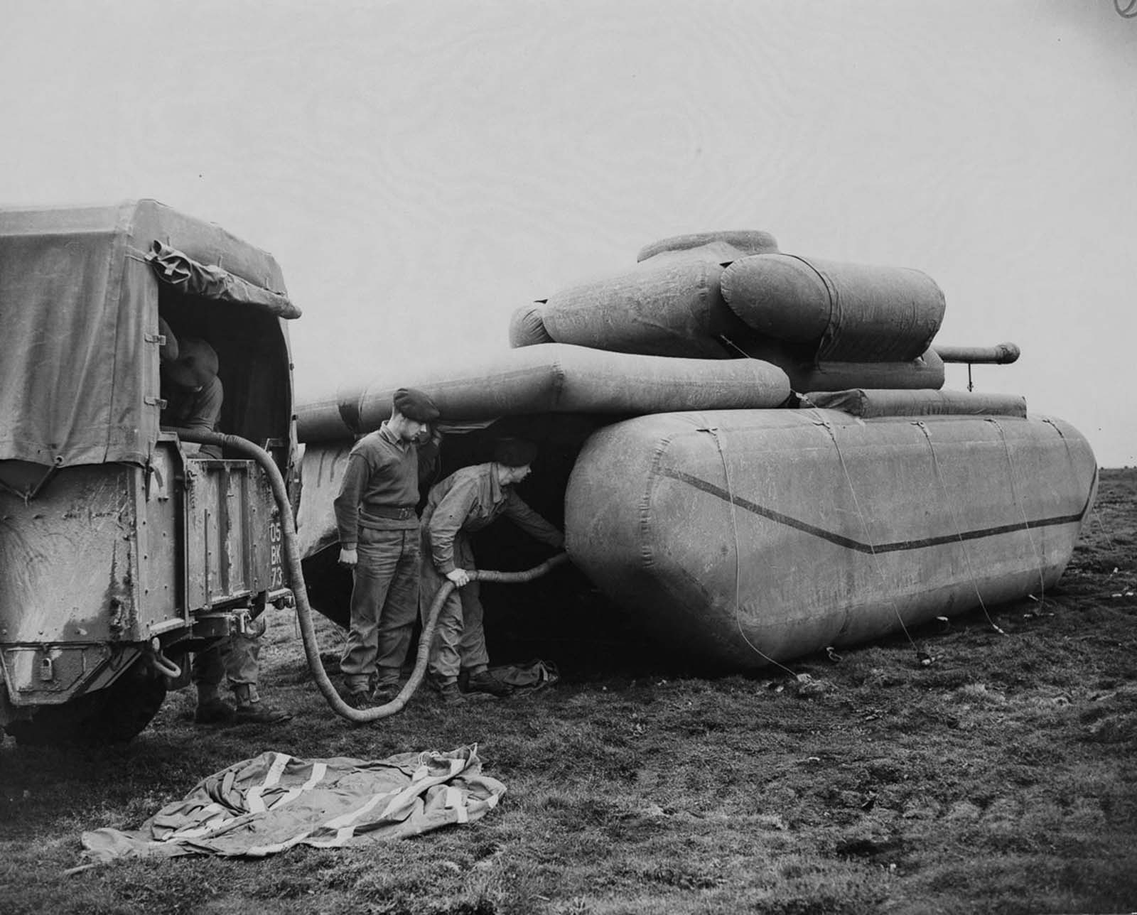 British troops inflate a rubber dummy tank. 1940.