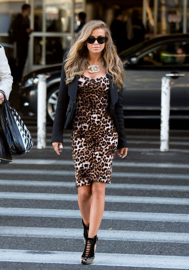 Carmen Electra arrives at LAX in a figure hugging leopard print dress