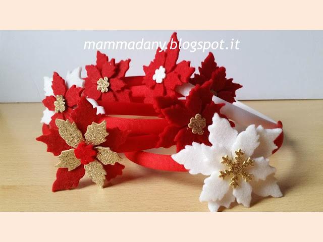 Cerchietti di natale con stelle di natale rosse oro e bianco