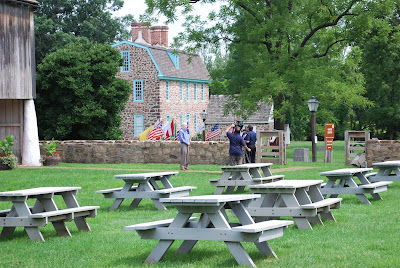 Camera crew filming outside visitor center at Graeme Park