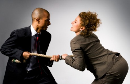 Man and woman entrepreneur playing tug of war