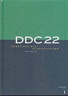 Book cover, first volume of DDC 22. Cover is divided horizontally into two shaded quadrants, with roughly the top one-third shaded green and the bottom two-thirds gray-to-blue.