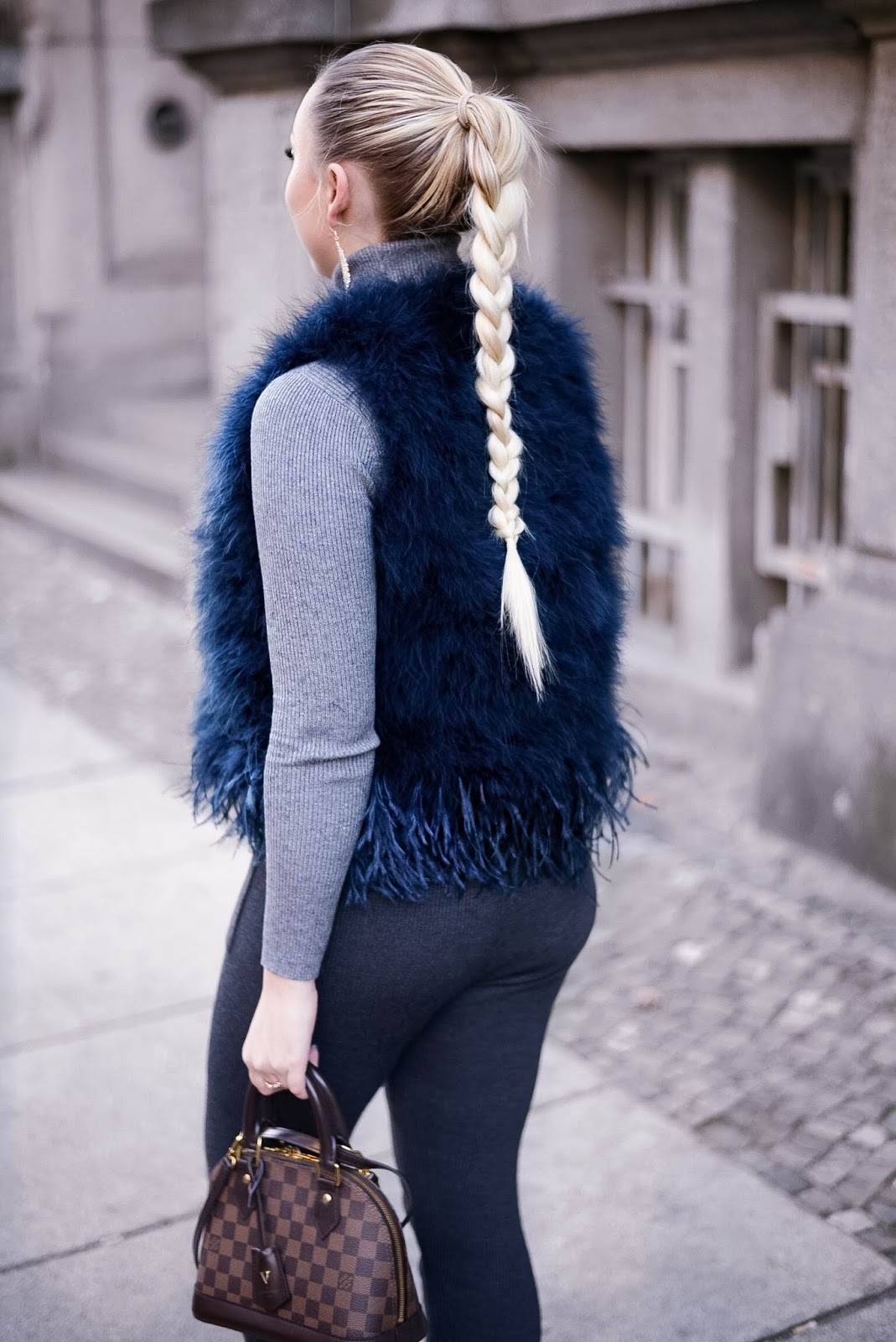 braided hairstyle_long natural hair_feather vest_knit on knit