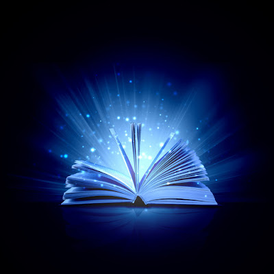 a book is opened against a black backdrop with magical lighting and stars