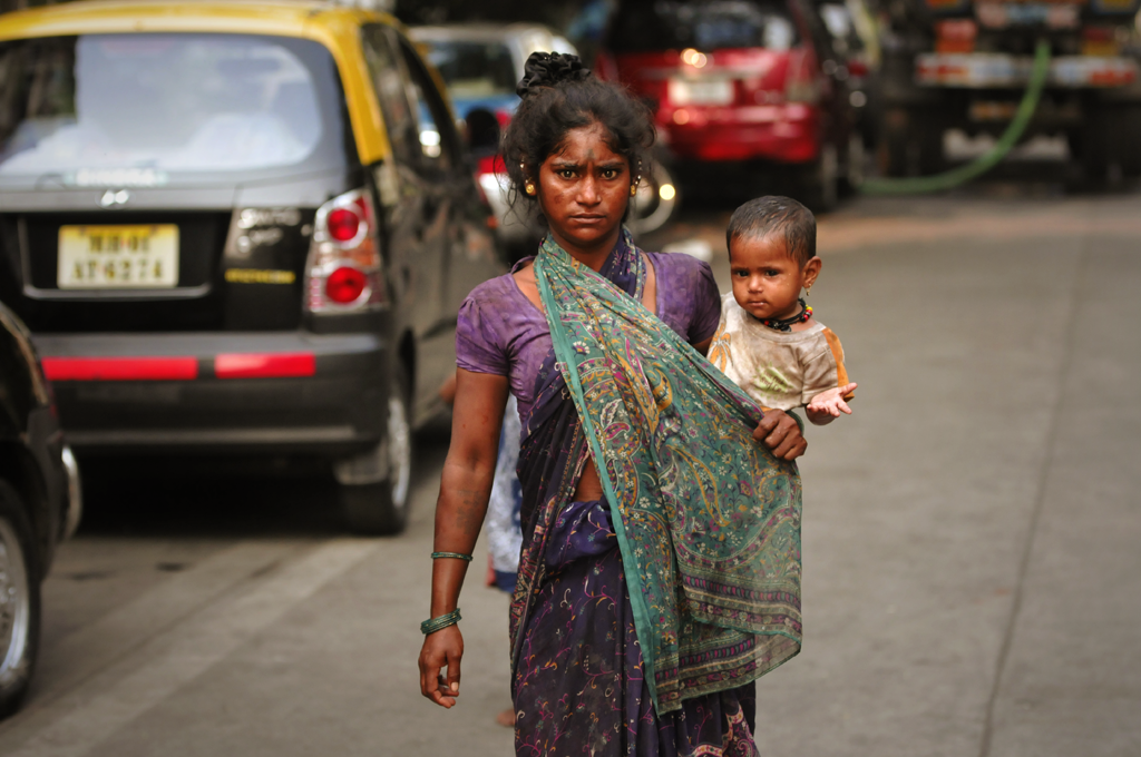 For the photographer, photographs are not so much about art as about telling a story or holding on to a memory about the way things used to be. For him, creating photographs is a straightforward matter. In this photo a young mother with a child on her shoulder in the Mumbai, India.