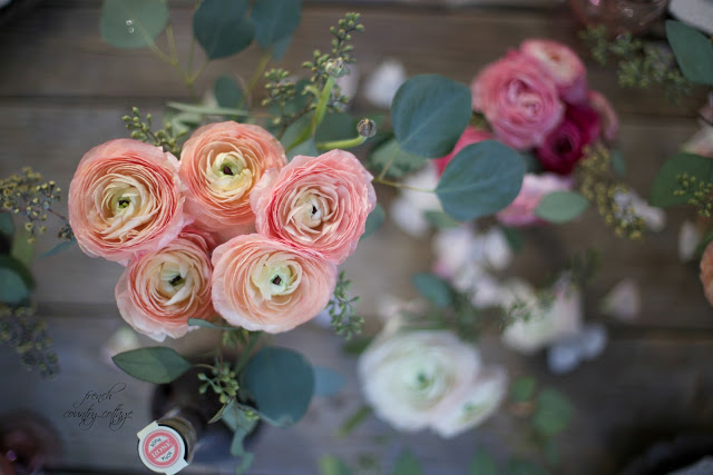 peach ranunculus with pink and white