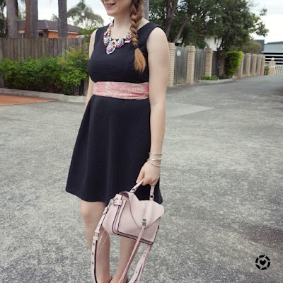 awayfromtheblue instagram black fit and flare dress pastel pink rebecca minkoff darren bag scarf as a belt