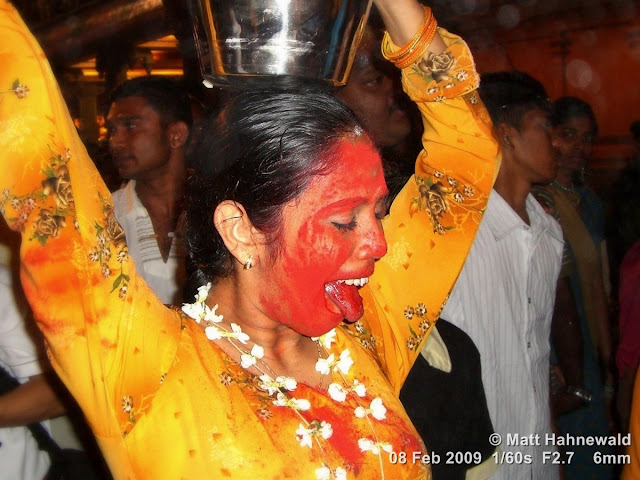 Thaipusam Festival, Malaysia, Kuala Lumpur, Batu Caves, kavadi attam, ceremonial sacrifice, ceremonial offering, Tamil woman, Hindu woman, Malaysian Indian woman, street portrait, trance